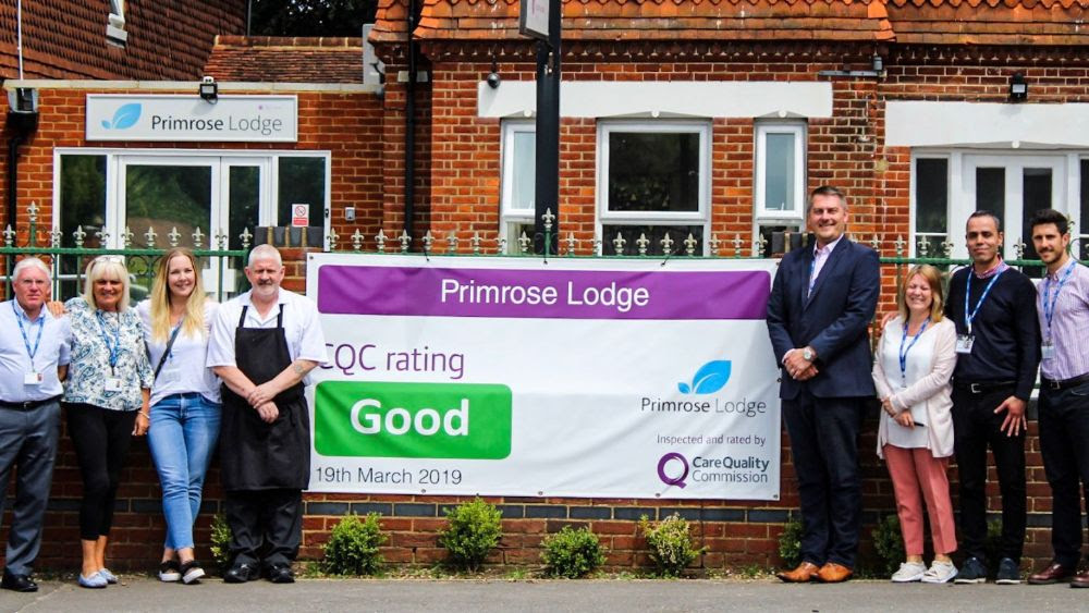 the primrose lodge team holding cqc result banner